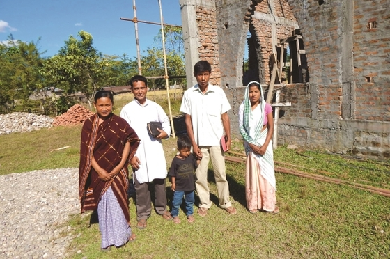 Aahan (man on right) was once bedridden from debilitating diseases. When he began to read a New Testament he received from GFA-supported pastor Dakshi (man on left), his faith grew to believe God would heal him.