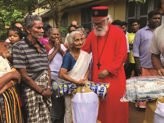 GFA founder, K.P. Yohannan, participated in a relief distribution event organized by GFA-supported workers.