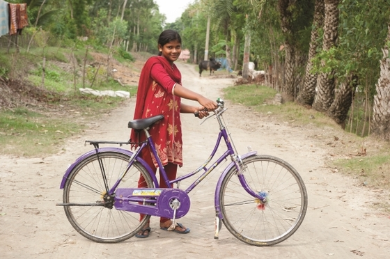 Pranita, like the girl pictured, received a bicycle that will give her the reliable transportation needed to continue her schooling.
