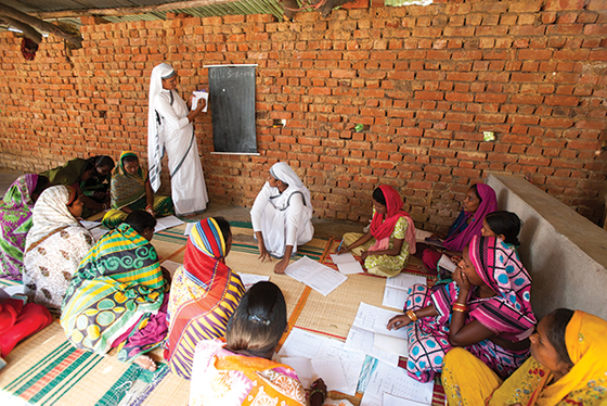 Several Sisters of Compassion hold a women's literacy class, much like the class Somya attended.
