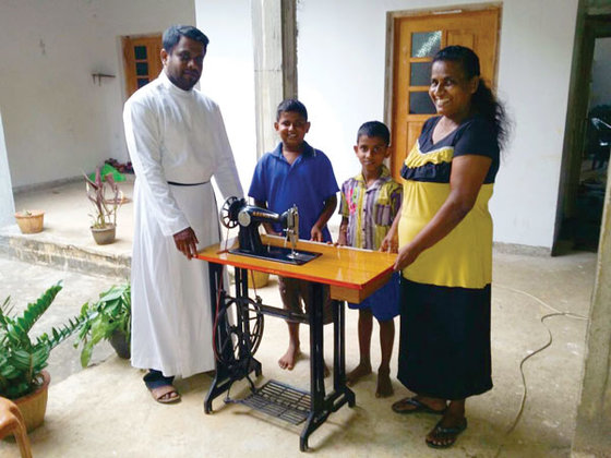 A GFA-supported pastor Jafet presents a life-changing sewing machine to Najma, empowering her to meet her family's needs.