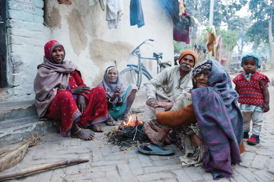 In extremely poor regions of Asia, many people depend on the heat of small fires and sunshine to survive the cold.