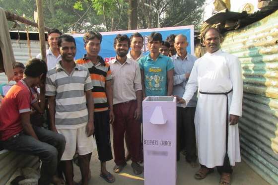 Families living in a slum joyfully received 10 BioSand water filters, enabling them to purify the filthy, polluted water that was making their families sick.