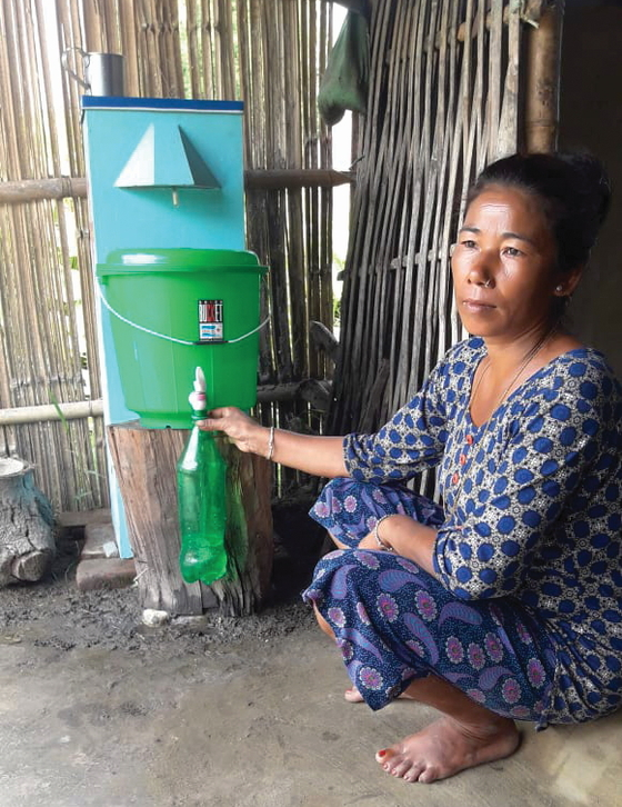 Beena with her BioSand water filter
