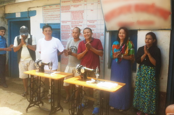 Pastor Jaitra (pictured in red) joyfully presented sewing machines and other helpful gifts to the inmates of a local prison.