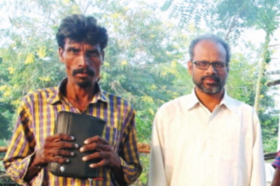 Dhir (pictured alongside a GFA worker) found hope through the ministry of a mobile team.