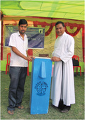 Bakul (left) with his new water filter.
