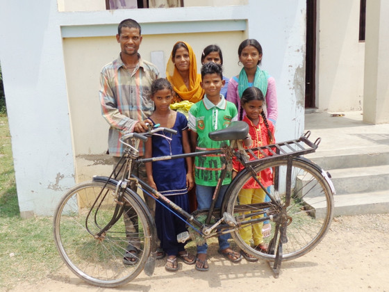 Hasan and his family with his new bicycle, a gift from GFA's Christmas Gift Catalog.