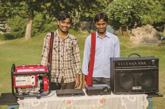 These are two GFA-supported missionaries standing by a generator, speaker, DVD player and LCD projector. Such equipment, provided through GFA friends like you, makes it possible for more people to hear and see the love of God displayed. Thank you!