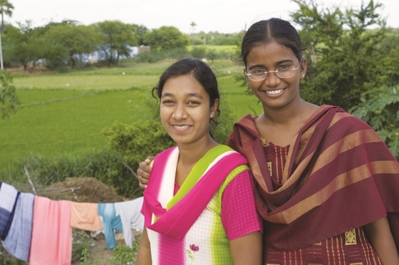 After learning about Jesus, many women, like these two pictured, choose to use their words to bring God glory.