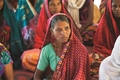 Like the woman pictured, Neeharika started gathering with other believers to learn more about God.