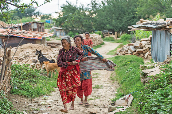 Abekwa and her family are some of thousands of people, like the women pictured, who have lost homes and possessions due to catastrophic earthquakes in their country.