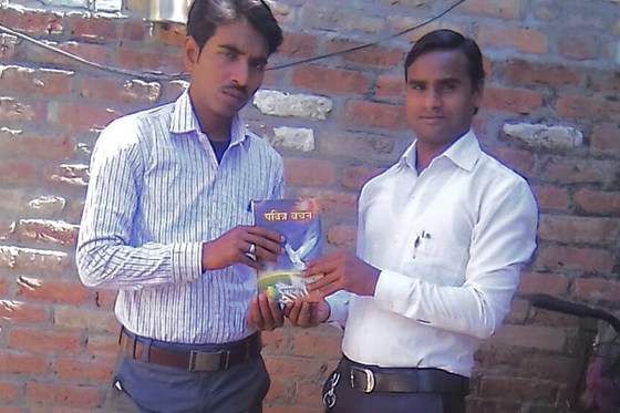Vedansh (left) finally found enduring peace when he read about Jesus in a New Testament he received from Pastor Vikranta (right)