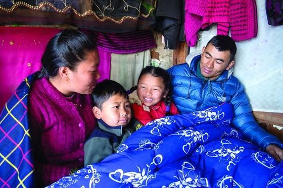 Rachana's family, like the one pictured, lives in a region where cold winter nights threaten the health of thousands of people who can't afford good blankets.