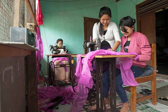 Income-generating gifts, like the pull cart Maret received or the sewing machines pictured, can help women start businesses and provide for their families.