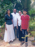 <p>Pastor Kilan, pictured with his family</p>