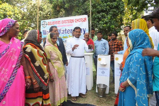 GFA pastor Sachen pictured with some of the people who he is giving these BioSand water filters to.