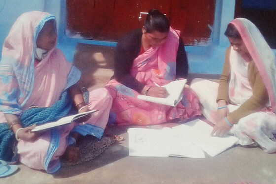 Kaleena is pictured with some other women in her literacy class.
