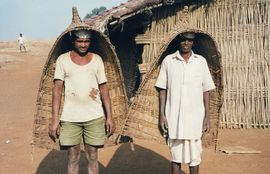 These two farmers demonstrate what they wear when the annual monsoon rains hit Maharashtra.