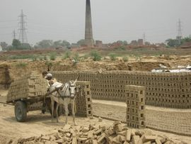 These men work making bricks by hand at one of the many manufacturing operations in Uttar Pradesh.