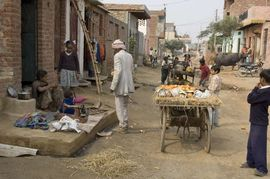 A street vendor sells his merchandise in a poor neighborhood in the Bareli Region.