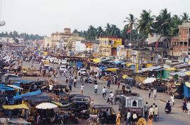 A bustling city street in Puri, part of the Bhubaneswar Orissa Region, is depicted here.