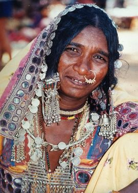 Tribal women in Central Gujarat enjoy wearing lots of jewelry and brightly colored fabrics.
