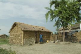 This simple Santali home is made from mud and grass.