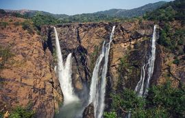 Magnificent scenery, such as this waterfall, draws tourists to the Central Karnataka Region.