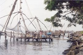 "Central Kerala fishermen still use the famous ""Chinese fishing nets"" that have become a symbol of the area."