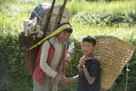 Porters carry supplies into remote mountain villages.