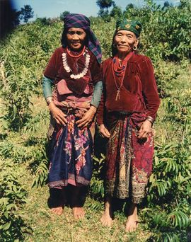 These women are wearing the traditional dress of their home country of Nepal. Nepalis are the largest tribal group in the Darjeeling Region.
