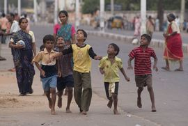 An estimated 100,000 homeless children live on the streets of India's capital city.