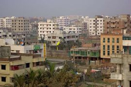 Many of Dhakha's middle-class residents are escaping the congestion and pollution of the capital city by moving to rapidly growing suburbs like this one.