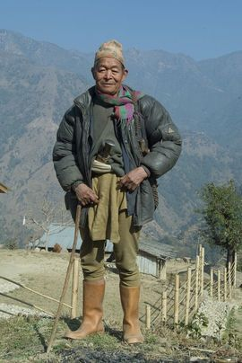 This Nepali man is dressed for the rugged 