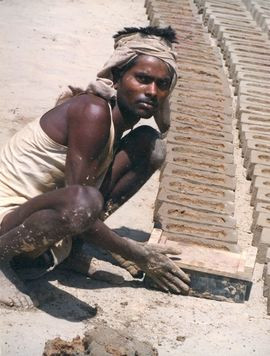 To help meet the demand of a rapidly growing state, this laborer makes bricks.