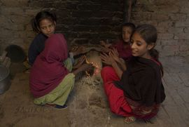 Summer temperatures in Punjab can reach 117 degrees Fahrenheit—but in the winter, it can drop below freezing and force families to huddle around fires in their warmest clothing.
