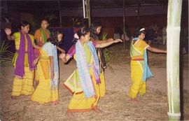 Golghat women perform a traditional dance during a village celebration.
