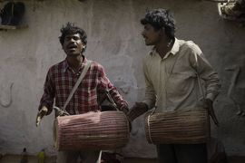 These performers are pouring their hearts into their music at a local festival in the Gorakhpur Region.