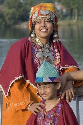 Kashmiri people wear colorful, heavy fabrics ornamented with metals such as bronze, silver and copper.