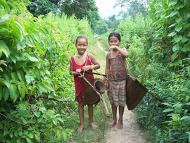 These Assamese children are equipped to catch some fish and bring them home in their baskets.