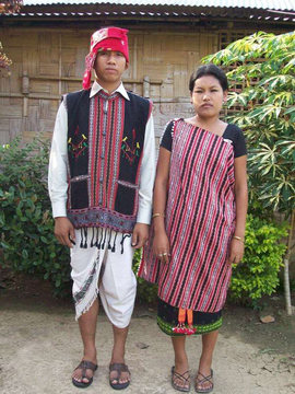 A young couple in the Karbi Anglong Region of Assam models their people's traditional festive clothing.