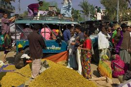 Once a week, hundreds of people crowd into the markets of a typical Khagrachari Region town. Rice, meat, vegetables and hundreds of different products are bought and sold in the narrow streets.
