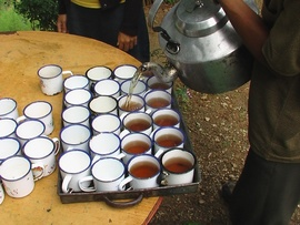Traditional Mizo tea made with local leaves is poured for a tribal gathering.