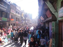 Residents and tourists mingle on this picturesque city street in the capital city of Aizawl.