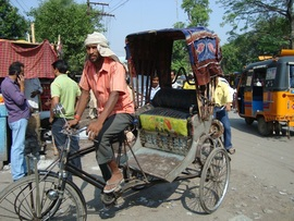 Driving a bicycle rickshaw is challenging work and requires a lot of effort.