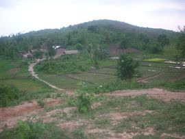 A home and fields on a plain backing up to one of the many hills is a typical scene in rural Nagaland.