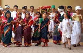 These North Karnataka children, performing a cultural dance, are growing up in one of the fastest-developing states in India.