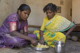 A mother and daughter in the North Karnataka Region share a simple meal together.