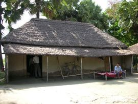 In this Santali tribal community, villagers live in simple huts made from mud, grass and sticks.